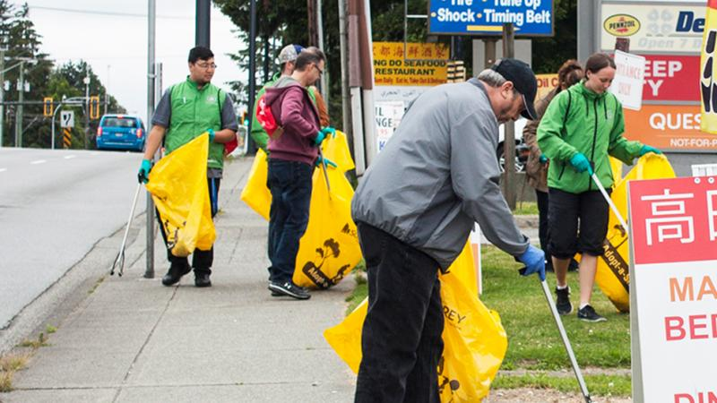 volunteers with yellow garbage bags
