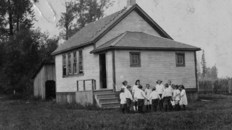 Black and White image of an old schoolhouse