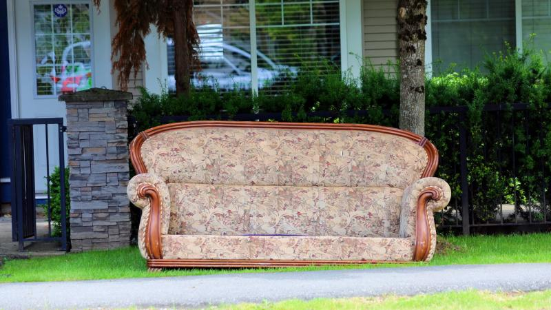 Vintage couch on the side of the curb