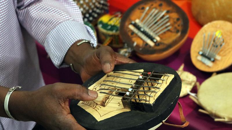 Man's hands close up playing instrument
