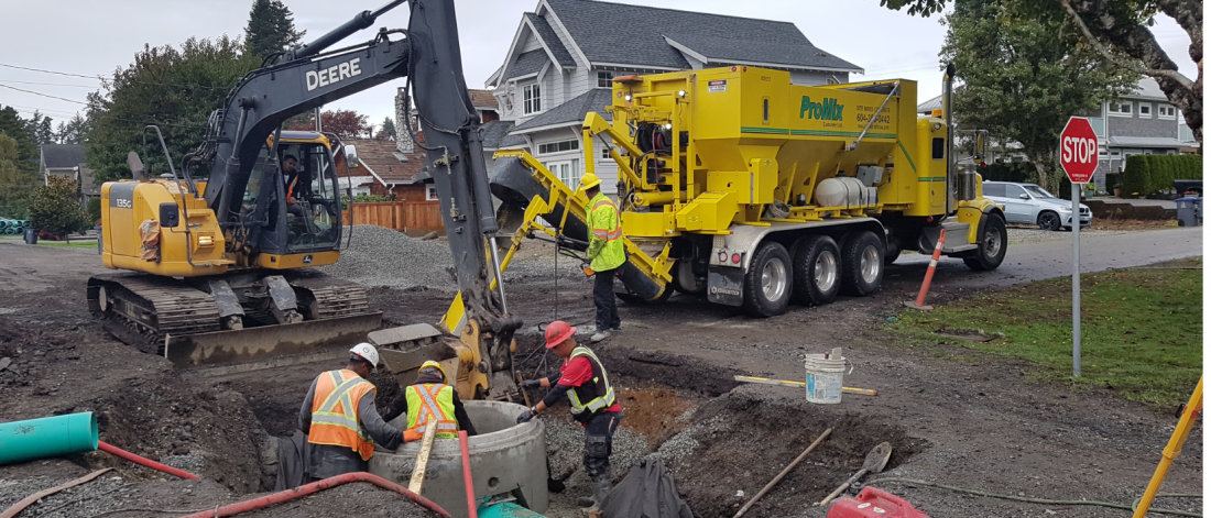 construction workers replace underground watermain