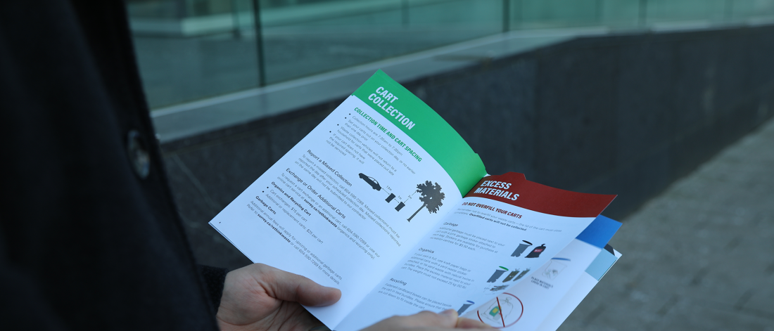 Person holding paper copy of the Rethink Waste booklet.
