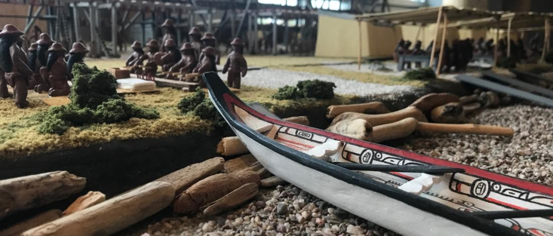 A canoe is featured as part of a diorama.