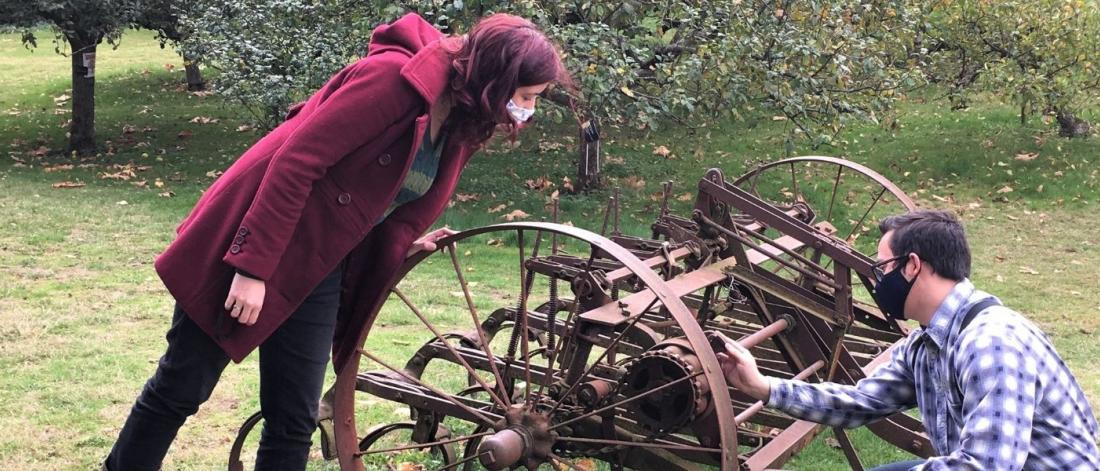 Old farming equipment in the orchard