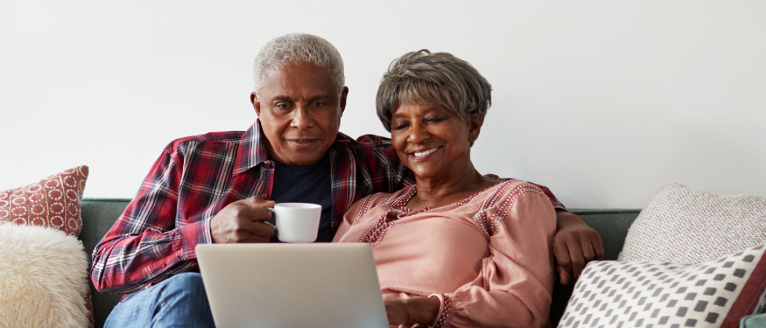 A seniors couple on their computer.