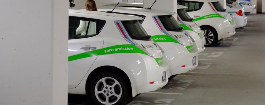 row of parked electric cars in parkade