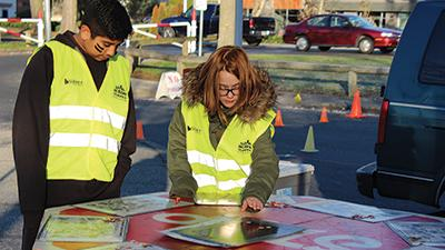two youth playing a traffic education game