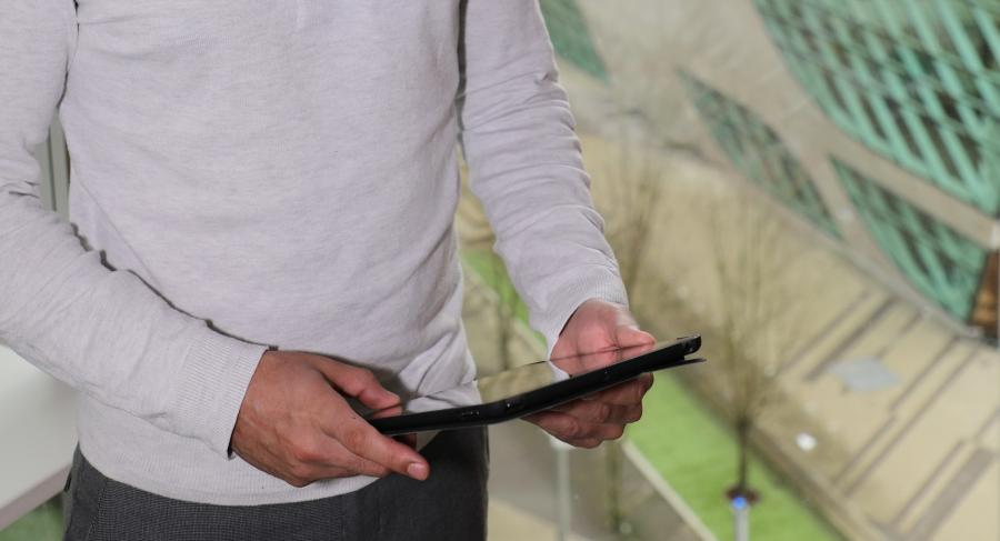 Staff Holding Tablet