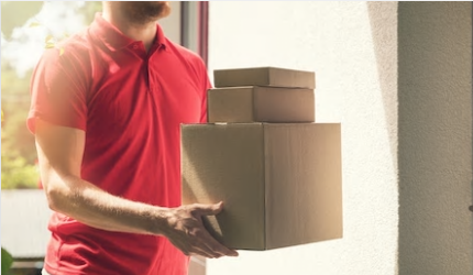 Man in red tshirt delivers boxes to home
